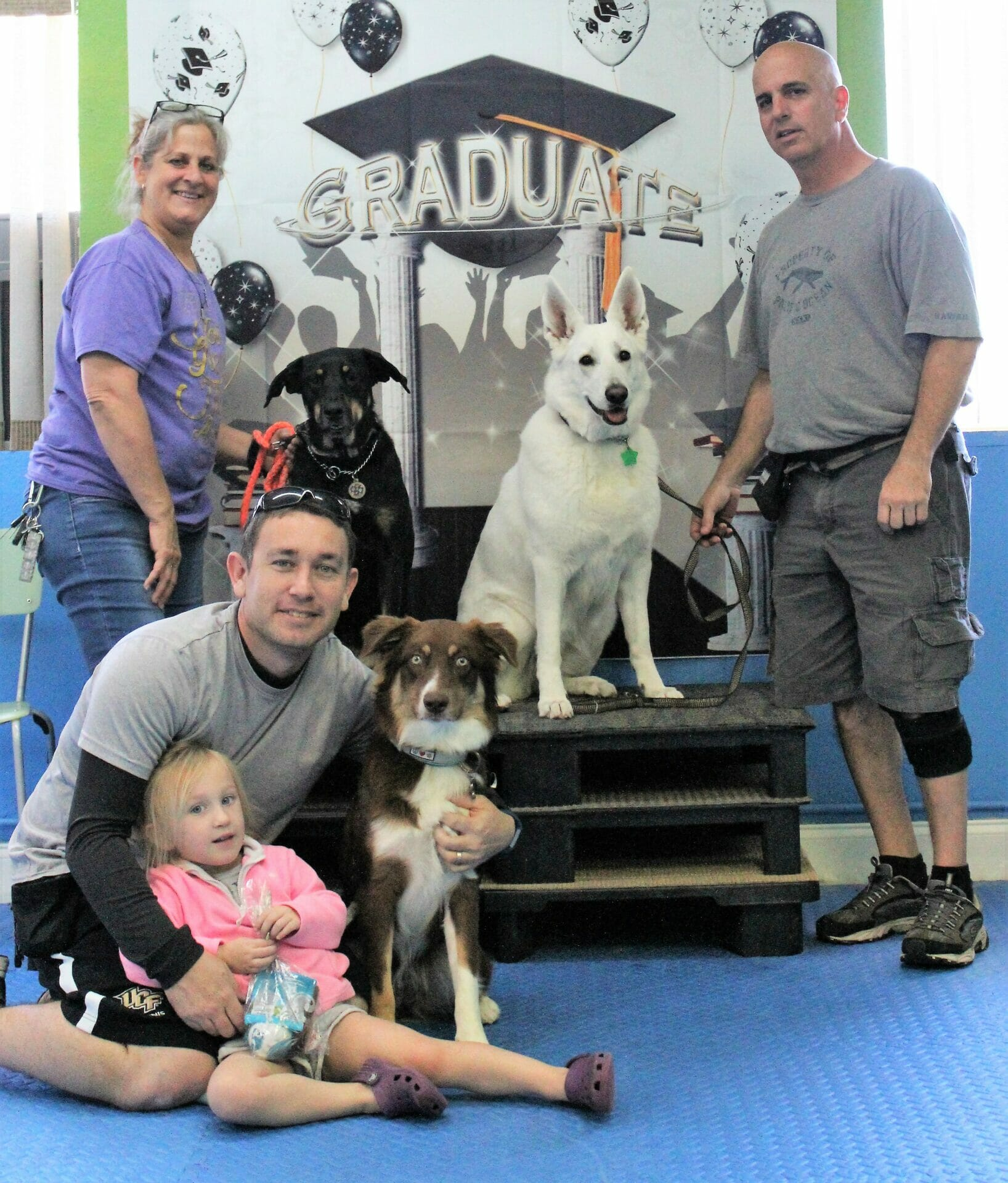Obedience Challenges Class graduation photo taken at Rockin' Dawgs Positive Dog Training facility in Rockledge, FL